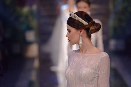 St. Petersburg, Russia - November 17, 2017: Wedding dress By Florentseva in the fashion parade of St. Petersburg Bridal Fashion Week. The event include 16 fashion collections