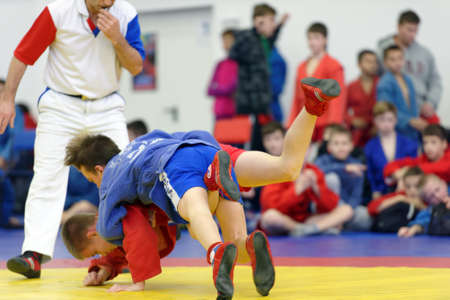 St. Petersburg, Russia - November 19, 2017: Young athletes competes in sambo wrestling during the All-Russian Sambo Day. The event is held annually since 2008