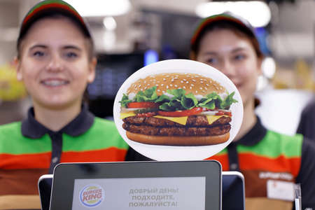 St. Petersburg, Russia - November 29, 2017: Staff of 500th Burger King restaurant in Russia in the service area in the day of opening. First Burger King restaurant opened in Russia in 2010