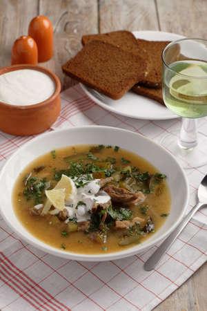 Rassolnik the traditional Russian soup prepared by retro recipe Stock Photo