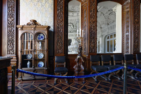 St. Petersburg, Russia - August 30, 2017: Interior of Oak dining room in Yusupov palace. The palace was erected in the late XVIII century, and now it acclaimed as the Encyclopedia of St. Petersburg ar 에디토리얼