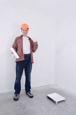 Contractor in hardhat with paint roller Stock Photo