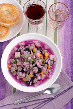 Purple carrot soup with meatballs and red wine Stock Photo