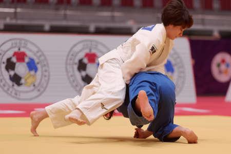 St. Petersburg, Russia - December 16, 2017: Final fight Miku Tashiro (white) vs Nami Nabekura, both of Japan during Judo World Masters tour. Tashiro won gold medal