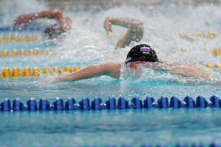 St. Petersburg, Russia - December 22, 2017: Men compete in freestyle swimming competitions during Salnikov Cup. The Cup is recognized as a preliminary of 2018 World Short Course Swimming Championship Editorial