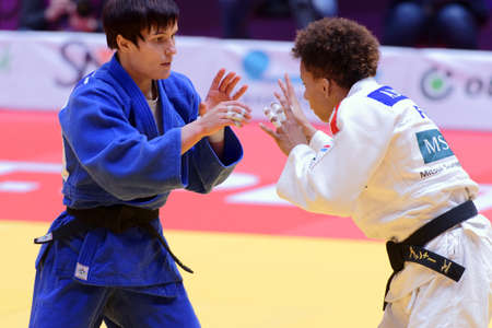 St. Petersburg, Russia - December 16, 2017: Final fight Natalia Kuziutina, Russia (blue) vs Amandine Buchard, France during Judo World Masters tour. Kuziutina won gold medal