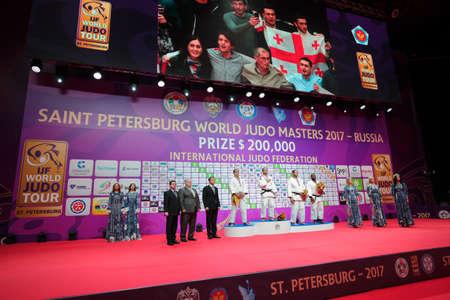 St. Petersburg, Russia - December 17, 2017: Winners in Men O100 during award ceremony of Judo World Masters 2017. Left to right on podium: Moura, Tushishvili, Silva, Mendoza