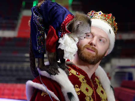 St. Petersburg, Russia - December 28, 2017: Andrey Teplygin with trained monkey during the press conference dedicated to the premiere of the show Snow Queen by Great Moscow circus in St. Petersburg