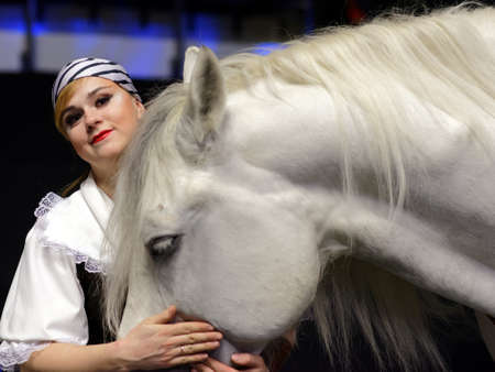 St. Petersburg, Russia - December 28, 2017: Violetta Alexandrova-Serge with horse during press conference dedicated to the premiere of the show Show Queen in St. Petersburg