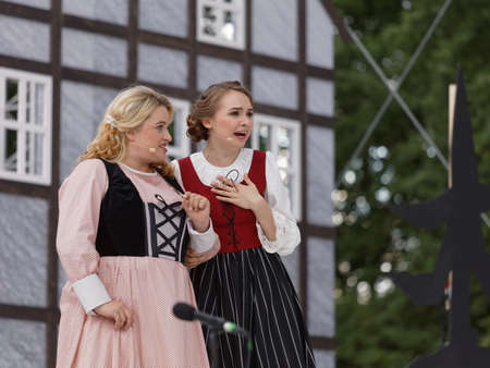 St. Petersburg, Russia - July 19, 2017: Micaela di Catalano (left) and Olga Cheremnykh in the opera The Marksman of C. M. von Weber outdoors during the festival All Together Opera. It was third of 4 performances