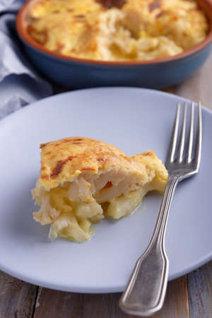 Cauliflower cheese in a baking dish Stock Photo