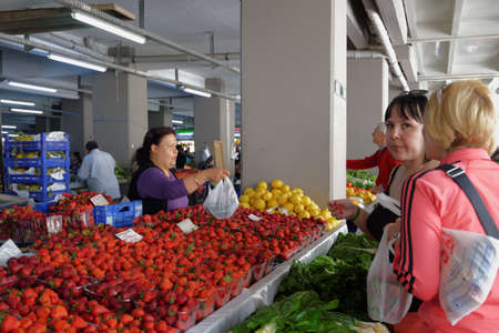 Marmaris, Turkey - May 1, 2014: People on the city farmers market. Although the market works only one day per week, locals prefer to buy here due to cheaper prices and broader assortment