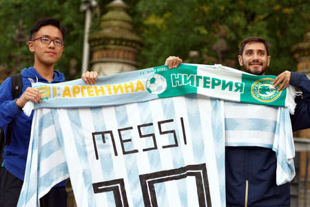 St. Petersburg, Russia - June 24, 2018: Argentinian football fans with the national team uniform number 10 Messi make photo before the match against Nigeria during FIFA World Cup Russia 2018 Editorial