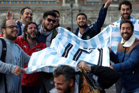 St. Petersburg, Russia - June 24, 2018: Argentinian football fans with the national team uniform number 10 Messi make photo at FIFA Fan Fest in Saint Petersburg during FIFA World Cup Russia 2018 Editorial