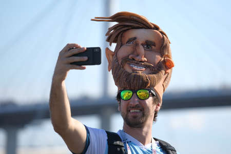 St. Petersburg, Russia - June 26, 2018: Argentinian football fan in mask of Lionel Messi makes selfie near Saint Petersburg stadium during FIFA World Cup 2018 before the match Argentina - Nigeria. Argentina won 2-1
