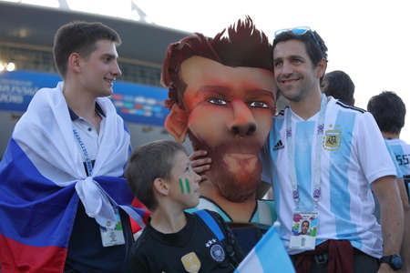 St. Petersburg, Russia - June 26, 2018: Argentinian and Russian football fans at the cartoon of Lionel Messi near Saint Petersburg stadium during FIFA World Cup 2018 before the match Argentina - Nigeria. Argentina won 2-1
