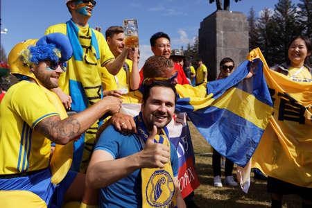 St. Petersburg, Russia - July 3, 2018: Swedish football fans make photo at Saint Petersburg stadium before the match of FIFA World Cup 2018 Sweden vs Switzerland. Sweden won 1-0