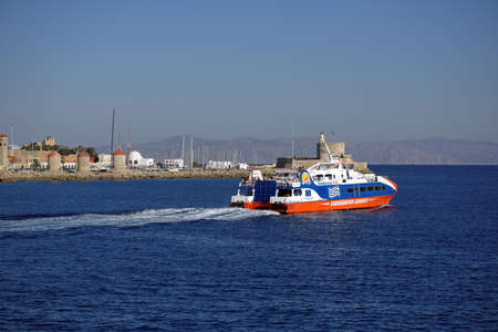 Rhodes, Greece - October 12, 2017: High-speed catamaran Dodekanisos Pride departs to Kalymnos. Built in 2005, the boat can carry 280 passengers and 9 cars