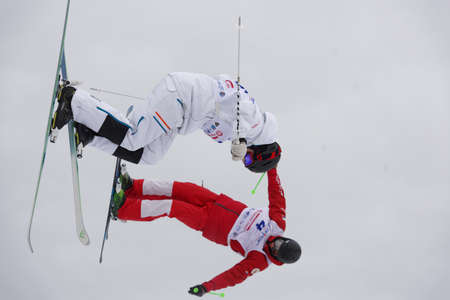 Krasnoe Ozero, Leningrad region, Russia - February 1, 2018: Albin Holmgren (white) of Sweden and Timur Rakhmatullin of Russia compete in dual mogul during Freestyle Europa Cup competitions. Holmgren won silver Editorial