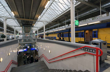 Amsterdam, Netherlands - January 1, 2017: People on the platform of metro and train station. The metro system consists of five routes and serves 58 stations, with a total length of 52.2 km