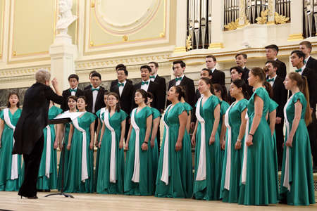 Saint-Petersburg, Russia - February 25, 2018: Youth Choir Alatau of Almaty Music College, Kazakhstan performs during V Children and Youth World Choral Championship. First championship was held in Hong Kong in 2011