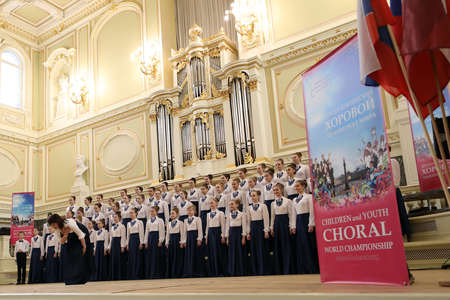 Saint-Petersburg, Russia - February 25, 2018: Choir Kapel, Russia performs during V Children and Youth World Choral Championship. First championship was held in Hong Kong in 2011