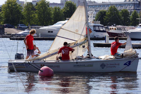 St. Petersburg, Russia - August 1, 2018: Athletes lowering their sails after the race of Saint Petersburg University Open Cup. This year teams from 9 countries take part in the Cup
