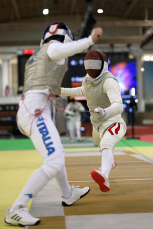 St. Petersburg, Russia - May 4, 2018: Edoardo Luperi, Italy vs Johannes Poscharnig, Austria in first competition day of Fencing World Cup Saint-Petersburg Foil. This annual tournament is hold in 44th time Archivio Fotografico - 112499785