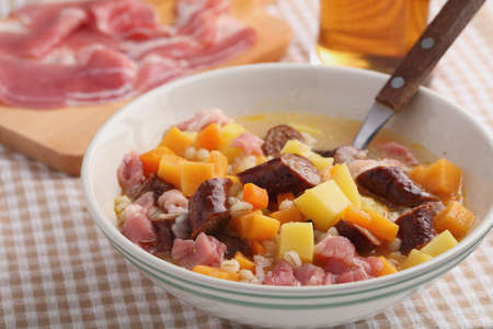 Traditional Irish dish Dublin coddle with sausages on a table
