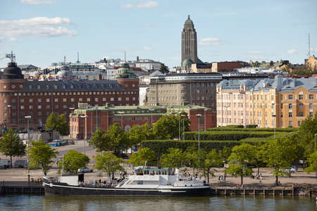 Helsinki, Finland - July 15, 2017: Cityscape of Finnish capital with Siltavuorensalmi bay and dominated Kallio Church. The grey granite church, completed in 1912, is one of Helsinki's most readily identifiable landmarks