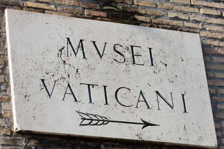Rome, Italy - August 17, 2018: Sign of Vatican Museums on the walls of Vatican city. It is one of the largest museums in the world