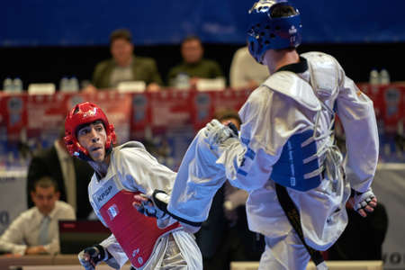 St. Petersburg, Russia - October 17, 2015: Taekwondo WTF junior teams match Russia vs Iran during the martial arts festival Baltic Sea Cup in Sibur Arena. The traditional festival is organized by martial arts school of Demid Momot