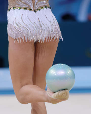 Kiev, Ukraine - August 30, 2013: Unidentified female gymnast performs with clubs during 32nd Rhythmic Gymnastics World Championships. The event is held in Palace of Sport