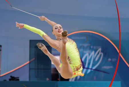 Kiev, Ukraine - August 29, 2013: Ganna Rizatdinova, Ukraine performs with ribbon during 32nd Rhythmic Gymnastics World Championships. The event is held in Palace of Sport