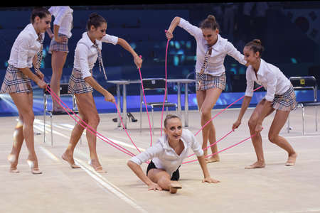 Kiev, Ukraine - September 1, 2013: Italian gymnasts perform the dance of office girls during closing ceremony of 32nd Rhythmic Gymnastics World Championships. The event is held in the Palace of Sports