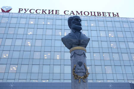 St. Petersburg, Russia - February 1, 2019: Monument to famous jeweler Peter Carl Faberge in front of jewelry factory Russkiye Samotsvety. The factory founded in 1912