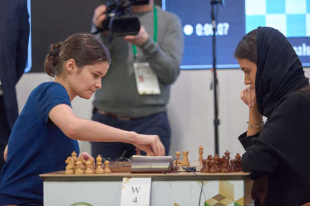 St. Petersburg, Russia - December 30, 2018: Match Anastasia Bodnaruk, Russia (left) vs Sarasadat Khademalsharieh, Iran during King Salman World Blitz Chess Championship 2018. Khademalsharieh won the match Editorial