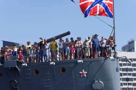 St. Petersburg, Russia - July 29, 2018. People watching the Navy Day parade from the deck of Russian cruiser Aurora. Navy Day is celebrated in the last Sunday of July