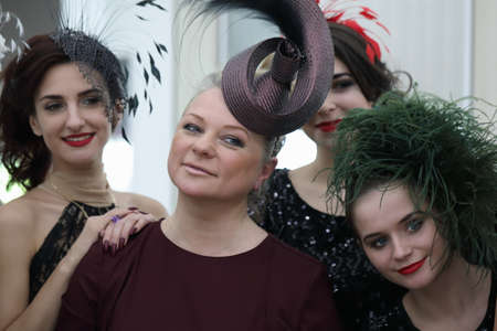 St. Petersburg, Russia - February 1, 2019: Fashion designer Anna Mikhailova posing with models presenting her collection of hats and accessories during Annual Jewelry Festival Faberge Heritage Editorial