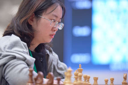 St. Petersburg, Russia - December 30, 2018: Ex-World Chess Champion Tan Zhongyi, China competes in King Salman World Blitz Chess Championship 2018. Eventually she took 5th place Editorial