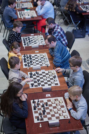 St. Petersburg, Russia - December 29, 2018: People playing chess in the Exhibition Hall Manege during World Rapid and Blitz Championships. Mass competitions aimed to popularize chess