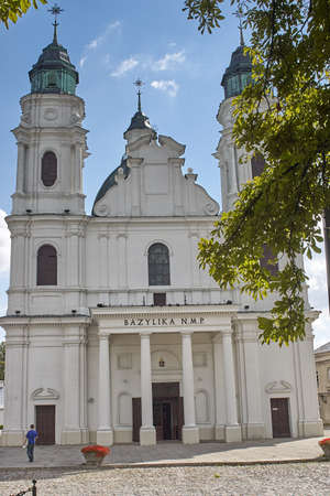 Chelm, Poland - September 4, 2006: People at the Basilica of the Birth of the Virgin Mary. The present late Baroque church was built in 1735-56 according to the plans of Pawel Fontana Editorial
