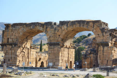 Pamukkale, Turkey - August 18, 2011: People at Bath-Basilica in the ancient city of Hierapolis. Since 1988, Hierapolis is listed as UNESCO World Heritage site