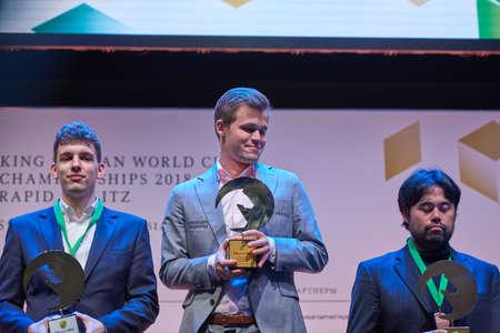 St. Petersburg, Russia - December 30, 2018: Award ceremony of World Blitz Chess Championship 2018. From left: Jan-Krzysztof Duda, Poland, Magnus Carlsen, Norway, Hikaru Nakamura, USA Editorial