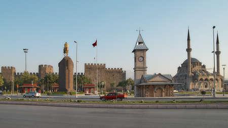 Kayseri, Turkey - July 27, 2007: Clock tower, monument to Ataturk, and Kayseri castle on Cumhuriyet Meydani square. Kayseri has outstanding Seljuk Turkish architecture Editorial