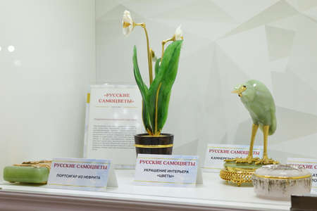 St. Petersburg, Russia - February 1, 2019: Exhibition of gemstone jewelry produced by the factory Russkiye Samotsvety in the opening day of jewelry festival Faberge Heritage. The festival includes jewelry exhibitions, master classes, lectures, contests, e
