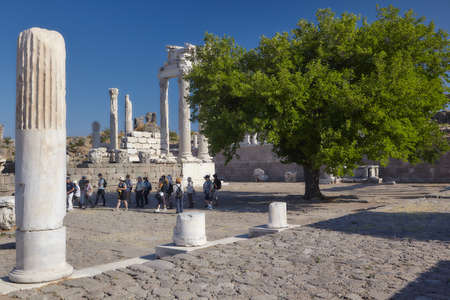 Bergama, Turkey - August 16, 2011: Tourist group in Acropolis of ancient Pergamon. Since 2014, Pergamon and its Multi-Layered Cultural Landscape is listed as UNESCO World Heritage