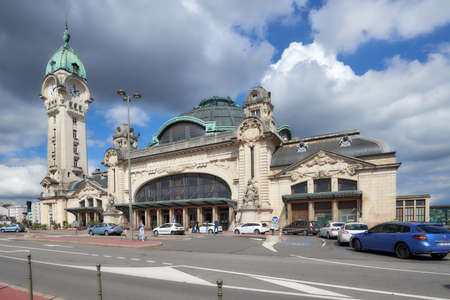 Limoges, France - September 10, 2013: People at Limoges-Benedictins Train Station in Limoges. Built in 1929, its considered as one of the most beautiful train station in the world Editorial