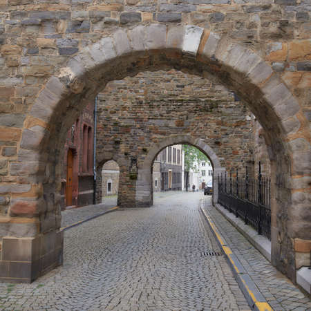 Maastricht, Netherlands - September 8, 2013: Medieval arches on Sint Servaasklooster street behind the Basilica of Saint Servatius. Maastricht is considered as the oldest city of Netherlands