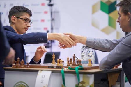 St. Petersburg, Russia - December 27, 2018: Match Alireza Firouzja, Iran (left) vs Dmitry Andreikin, Russia during King Salman World Rapid Chess Championship 2018. Andreikin won the match